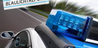 Symbolbild. Schräge, nahe Draufsicht auf die Fahrerseite eines Polizeiautos.